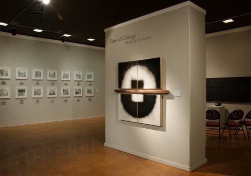 """The exhibit includes a variety of media, including Julie Comnick's """"Ashes to Ashes,"""" made using charcoal from fire sites  and audio recordings of conversations about fire ."""