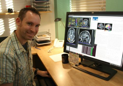 Assistant professor Stephen Wilson studies how the brain processes language by combining brain imaging with performance-based language tests.