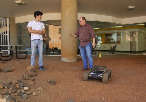 Wolfgang Fink and his team, including student Alex Brooks , are working on building a robotic field geologist.