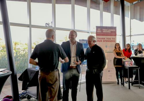From left: Doug Hockstad, Adam Small of Urbix Resources and UA President Robert C. Robbins.