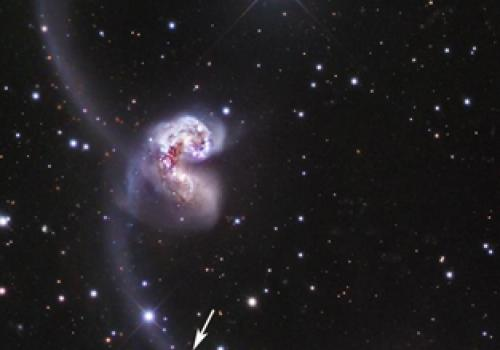 The arrow points to a supernova discovered in a nearby pair of colliding galaxies called the Antennae. The supernova was discovered in the Catalina Real-Time Transient Survey that uses data collected by UA Lunar and Planetary Laboratory observers using te