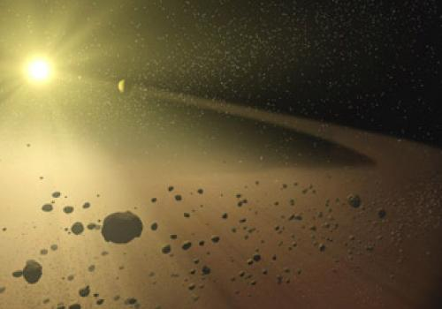 In this artist's concept, a narrow asteroid belt filled with rocks and dusty debris orbits a star similar to our own sun when it was approximately 30 million years old.