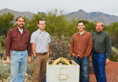 CAES researchers stand next to a receiving coil used by the Laboratory for Advanced Subsurface Imaging to conduct underground imaging. Left to right are ECE professor Steve Dvorak, MSE technical staff member Bennett Meulendyk, ECE graduate student Alex Ja