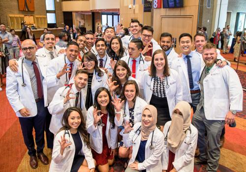 The College of Medicine – Phoenix presented white coats and stethoscopes to 80 members of the Class of 2023 on July 19 during ceremonies at Symphony Hall in Phoenix.