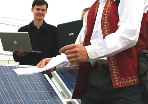 Alexander Cronin, right, UA associate professor of physics and optical sciences, monitors daily performance of several different types of photovoltaic modules. Physics doctoral candidate Vincent Lonij, also pictured here, is a member of the monitoring tea