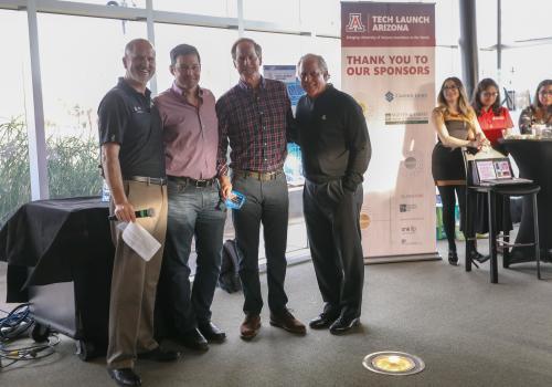 From left: Doug Hockstad, Curtis Gunn and Base Horner of the Desert Angels, and UA President Robert C. Robbins.