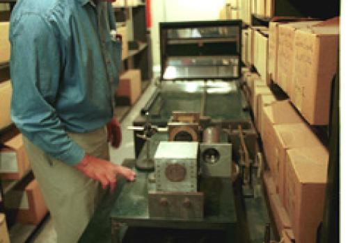 Shaw Kinsley checks the optics on A.E. Douglass' cycloscope, stored at the Arizona State Museum.