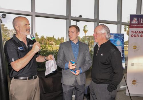 From left: Doug Hockstad, Dawson Baker and UA President Robert C. Robbins