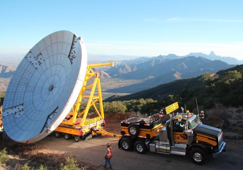 With the new antenna in tow, a special haul truck crawls up the winding road to Kitt Peak.