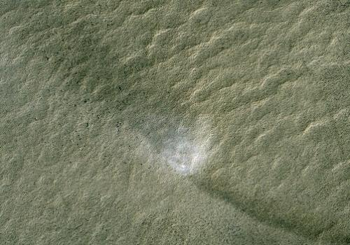 The swirling vortex of dust is visible near the center of this part of the new HiRISE image. The shadow cast by this column of dust can be seen in the upper-left, while the dark track left by the passage of the dust devil is evident in the lower-right.