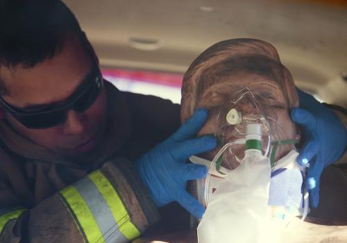 An emergency medical responder with Northwest Fire District practices treating a traumatic brain injury patient using EPIC treatment protocol.