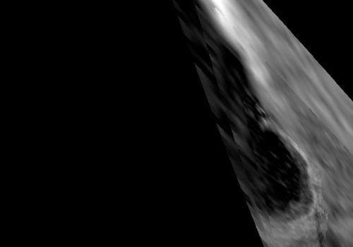 The visual and infrared mapping spectrometer  aboard NASA's Cassini orbiter captured this detailed, partial view of Titan's Ontario Lacus at 5 microns wavelength from 1,100 kilometers away, or about 680 miles away, on Dec. 4, 2007. Only part of the lake i