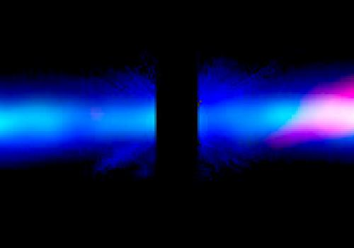 In this composite image of the large, edge-on, gas-and-dust disk encircling Beta Pictoris, visible light is blue, dust is green and carbon monoxide gas shows up as red. The image shows a curious asymmetry in the dust and gas distribution. This may be the