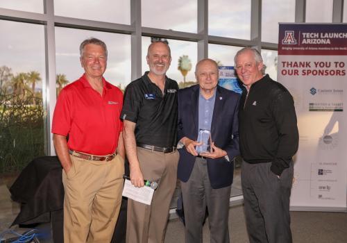 From left: David Allen, Doug Hockstad, James C. Wyant and UA President Robert C. Robbins.