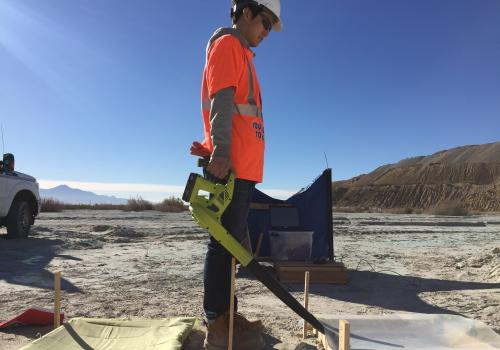 Materials science and engineering doctoral student Taehee Lee uses a blower to create a 25 mph wind to measure generated dust concentrations from the surface where dust suppressants were applied two weeks prior. The tests were done at the closed tailings
