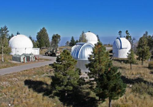 The 24-inch telescope is enclosed atop Mount Lemmon within the dome at the left.