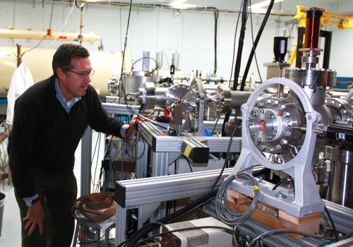 Greg Hodgins checks on the accelerator mass spectrometer, which narrowed the age of the book down to 1404 to 1438, in the early Renaissance.