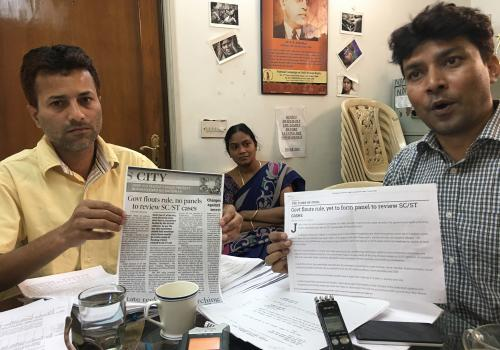 Some of the research study participants are pictured in the Delhi offices of the National Dalit Movement for Justice, India, which works to address caste discrimination and advancement of the rights of Dalit and indigenous individuals.