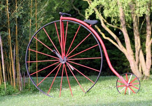 """The earliest bicycle design, called the """"ordinary,"""" """"penny farthing"""" or """"hi-boy,"""" was very tall with a disproportionately large front wheel. The introduction of the """"safety"""" design seen in modern bicycles made riding more accessible to all, beginning in t"""