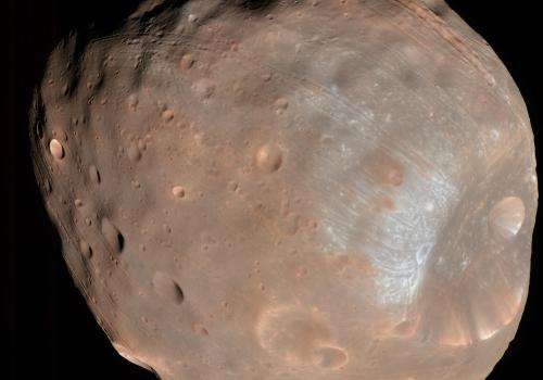 The HiRISE camera on the Mars Reconnaissance Orbiter took two images of the larger of Mars two moons, Phobos, within 10 minutes of each other on March 23, 2008. This is the first. Stickney is the large crater on the right.