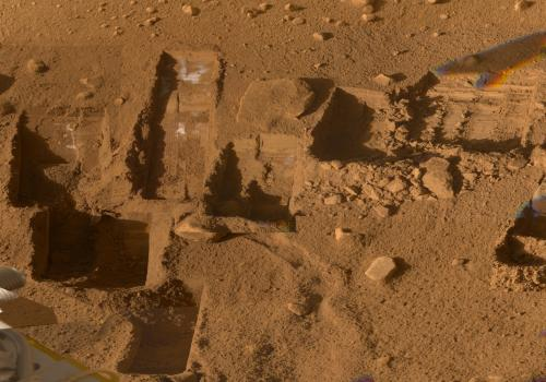Several of the trenches dug by NASA's Phoenix Mars Lander are displayed in this approximately true color mosaic of images from the lander's Surface Stereo Imager camera.  The component images were taken on various dates during the five months that Phoen