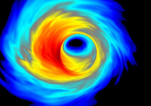 A computer simulation of superheated plasma swirling around the black hole at the center of our galaxy.