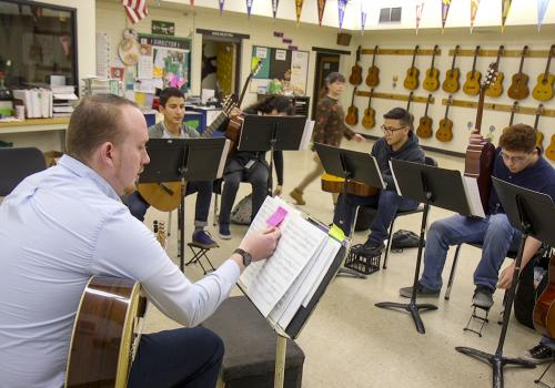 Steven Lerman , who just completed his Doctor of Musical Arts at the UA, helps teach guitar in the Lead Guitar program at Amphitheater High School.