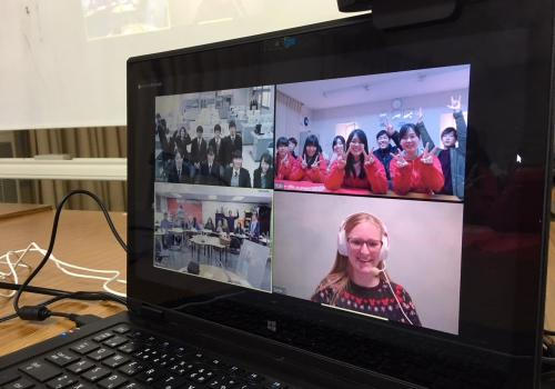 Students from Changemaker High School  and UA master's student Sarah Johnson  meet via videoconference with teens in Japan.
