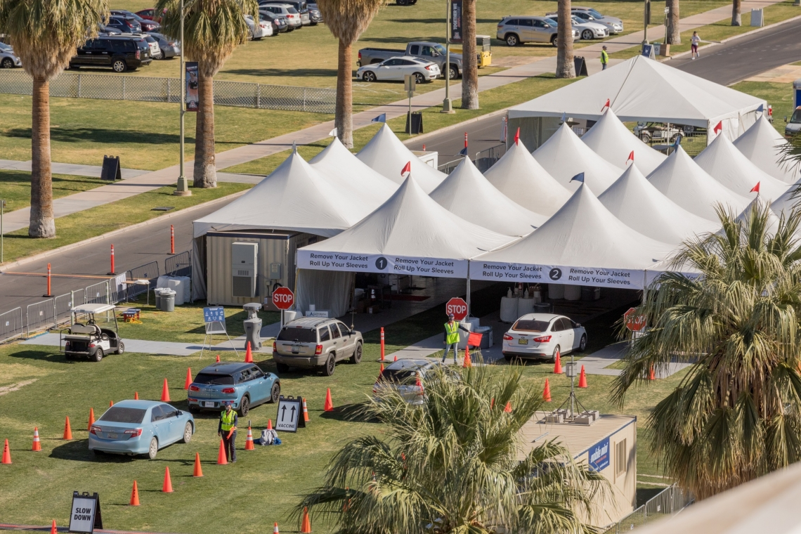 cars line up under tents on UArizona Mall