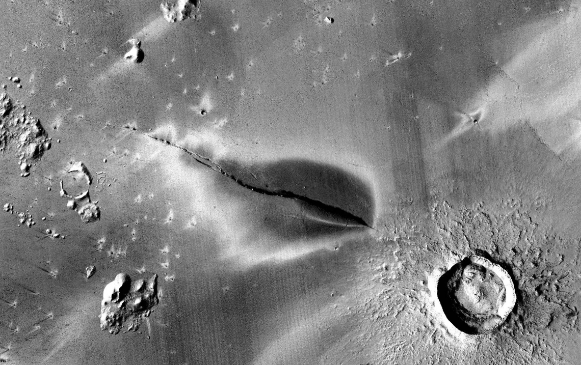 An aerial shot in black and white that shows a dark volcanic deposit