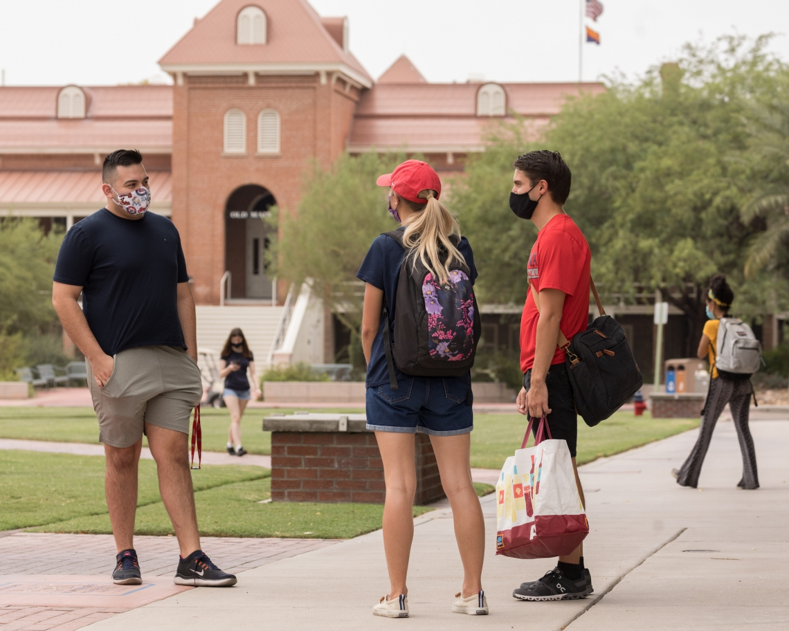 students wear masks on campus