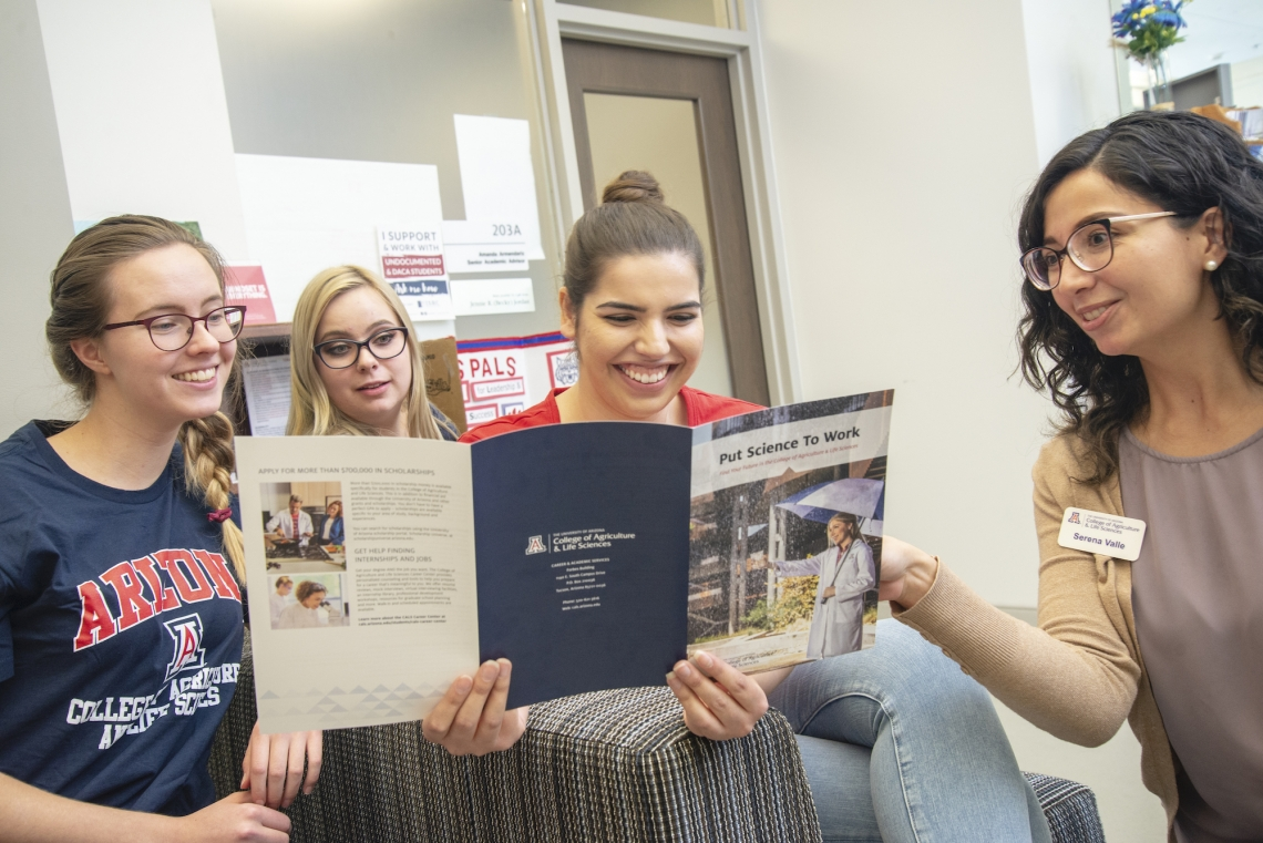 students reading a flyer