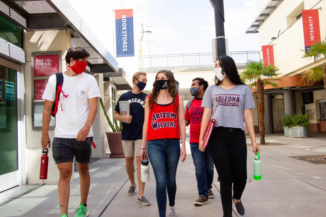 students walking together wearing masks