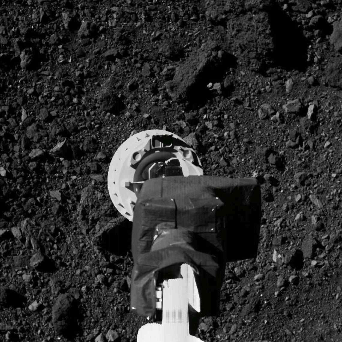 OSIRIS-REx sample arm and Bennu surface