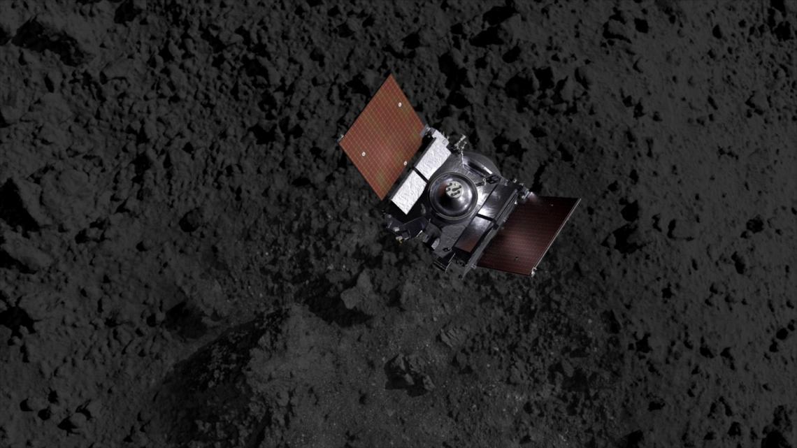 Artist's impression showing the OSIRIS-REx spacecraft descending onto Bennu's surface