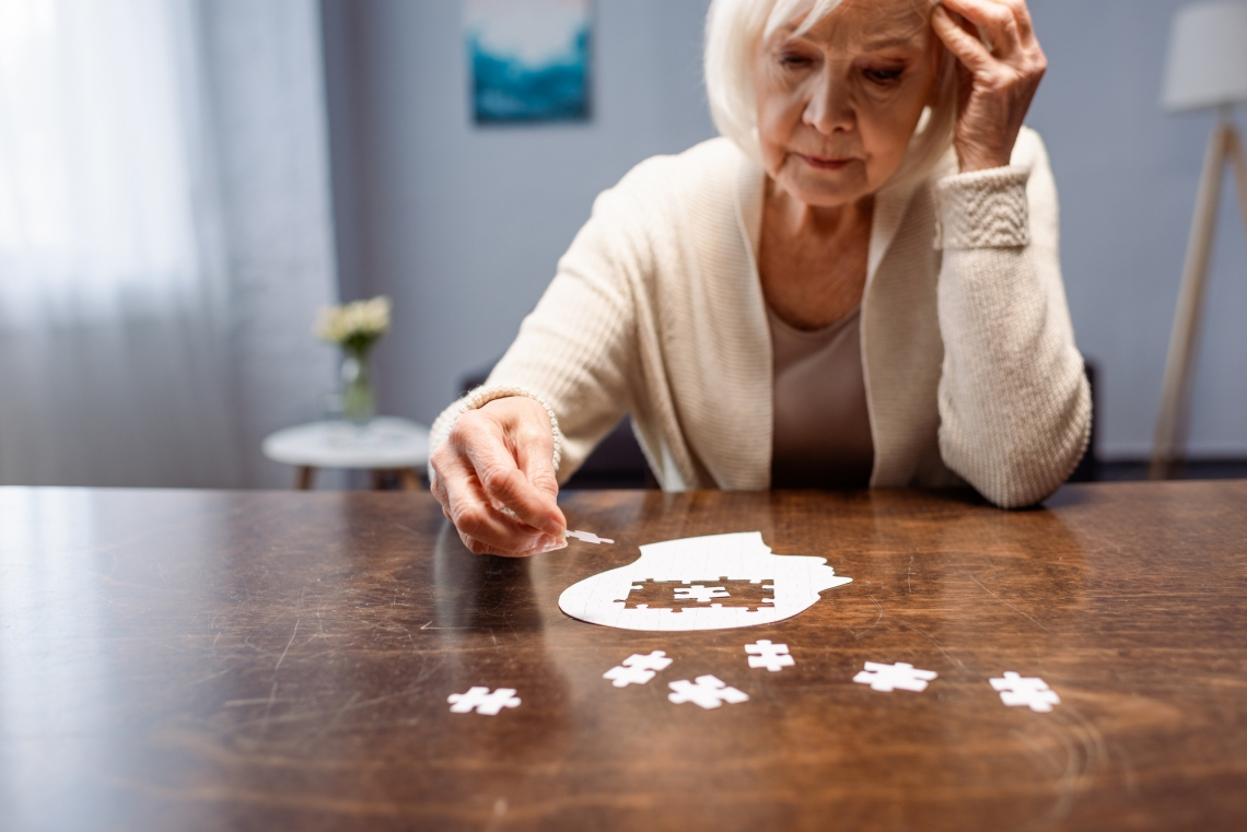 woman completing a puzzle