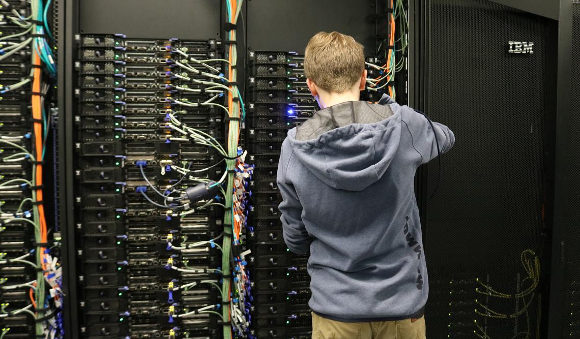 An UITS staffer with a supercomputer