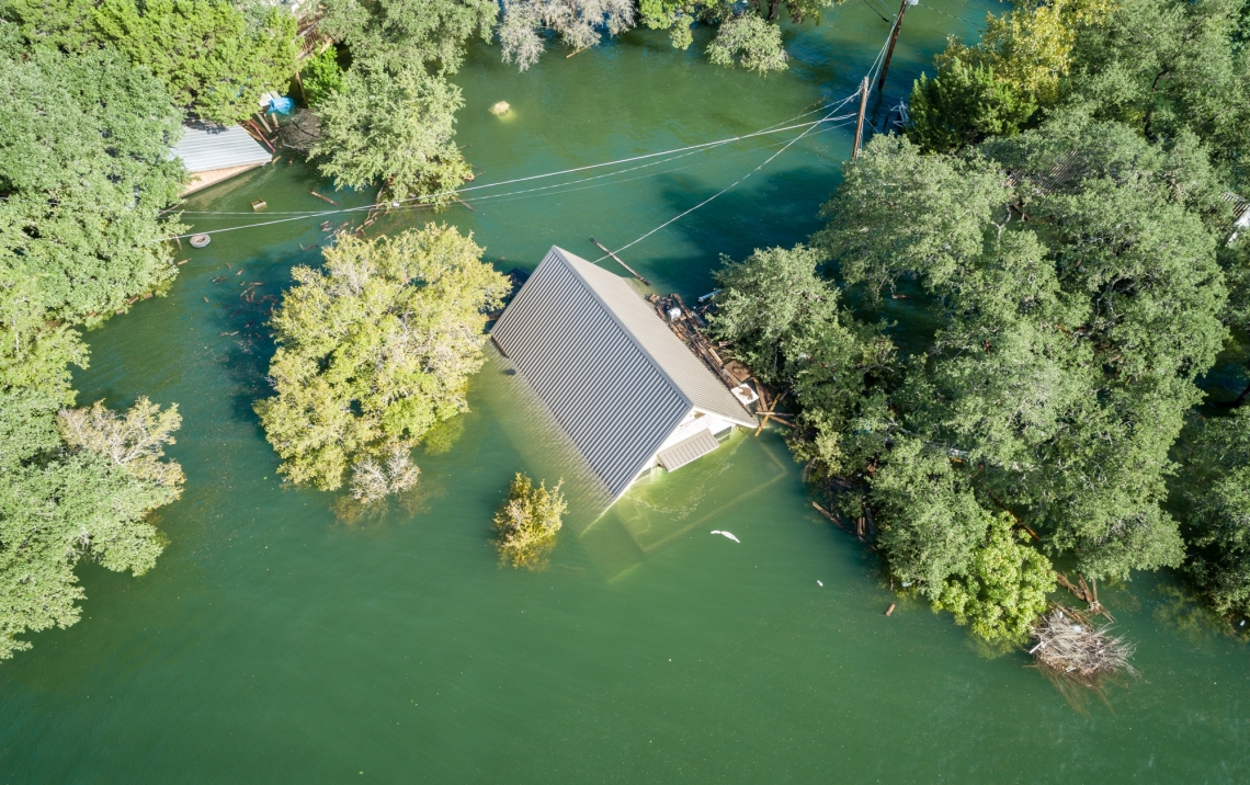 aerial view of a rooftop just above flood waters
