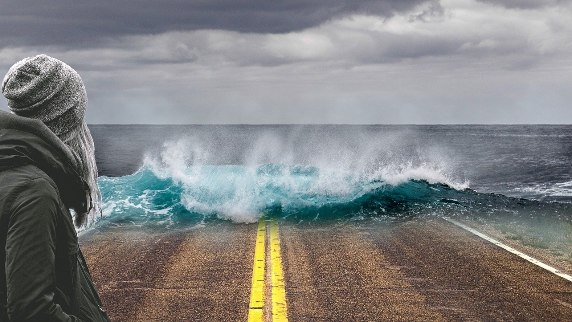 Waves breaking over a road