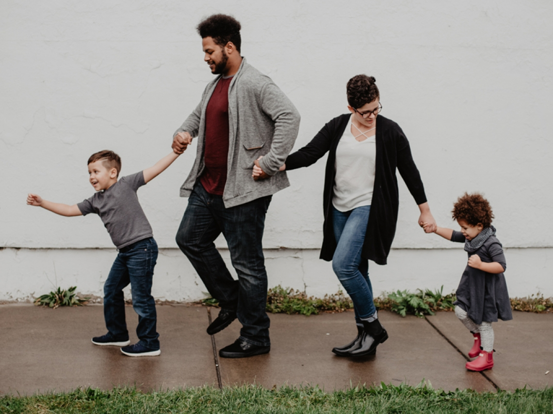 Family walking in the rain.