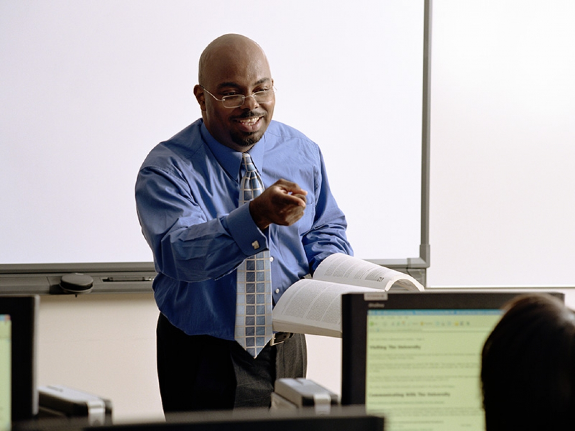 A man standing at the front of a classroom
