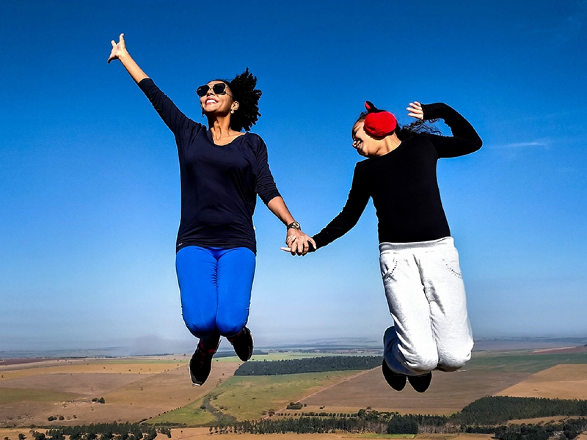 Two people jumping.