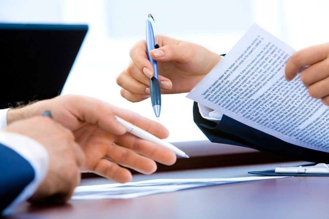 closeup of two people's hands at a desk