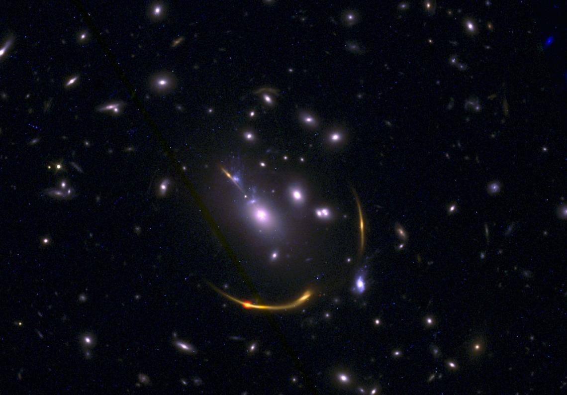 Gravitationally lensed galaxy cluster MACSJ 0138