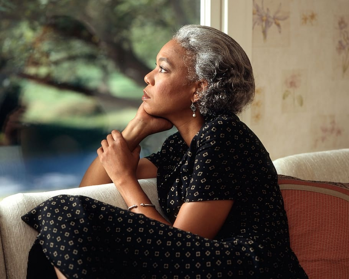 Woman thinking and looking out a window