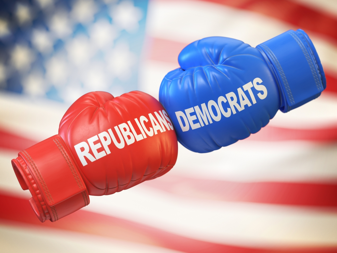"""a red boxing glove that says """"Republican"""" and a blue boxing glove that says """"Democrat"""""""