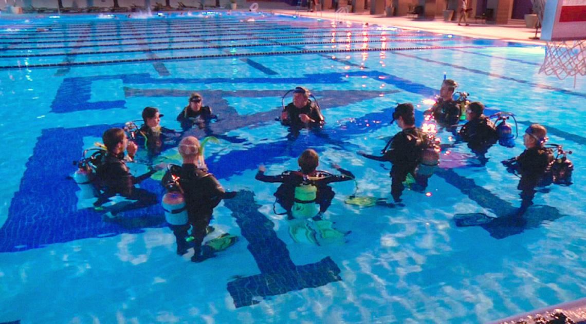 Mark Edwards teaches students essential scuba skills in the UA Student Recreation Center's Olympic-size pool.