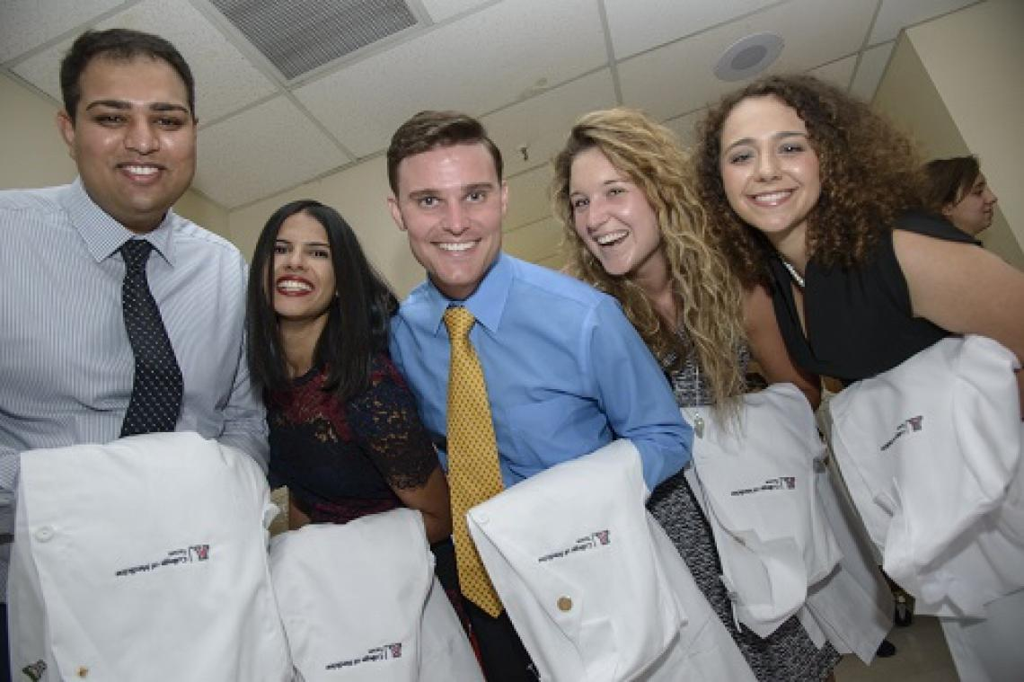 Arif Muhammad, Amisha Singh, Kevin Severson, Jessika Iwanski and Nicole Bejany at the ceremony, which honors new medical students as they accept the responsibility of the doctor-patient relationship. Each student receives a acoat and a stethoscope, thanks