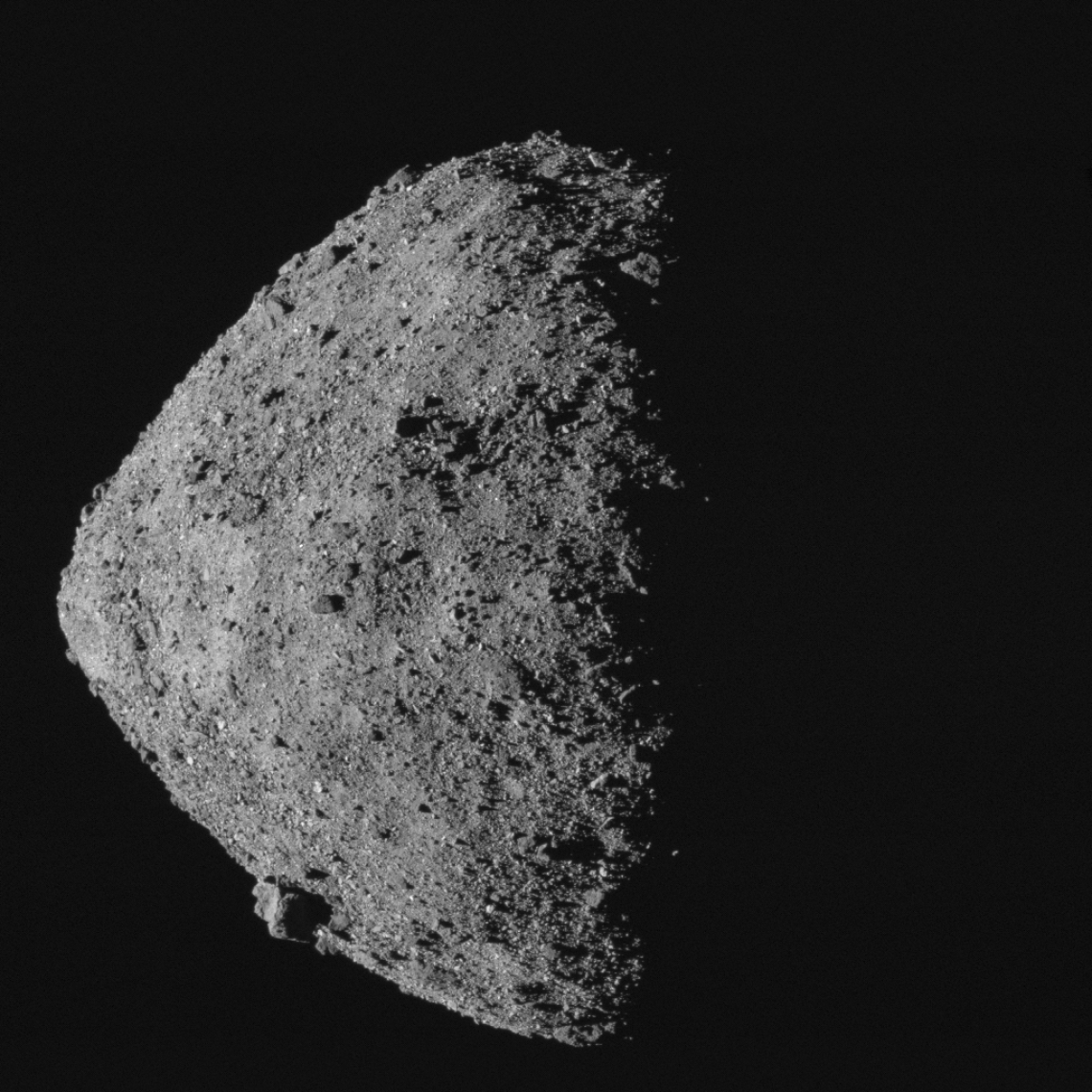 This image, showing asteroid Bennu's spinning-top shape, was taken by the MapCam camera on NASA's OSIRIS-REx spacecraft on April 29, from a distance of 5 miles. From the spacecraft's vantage point, half of Bennu is sunlit and half is in shadow. 