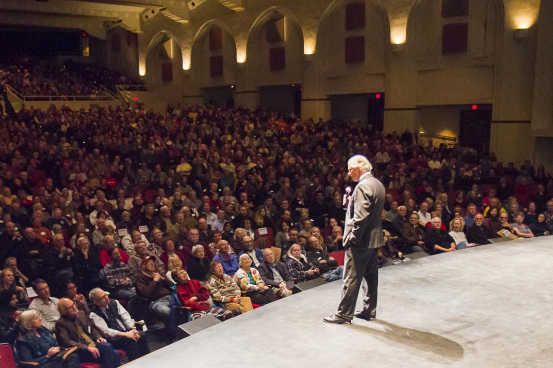 UA President Robert C. Robbins addresses the Centennial Hall audience before the start of Monday night's science lecture.